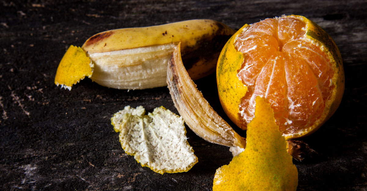 use orange and banana peels to repel ants and aphids in your garden