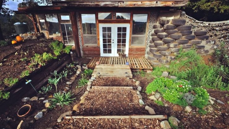 How This Couple Built An Earthship Tiny Home For Less Than 10k
