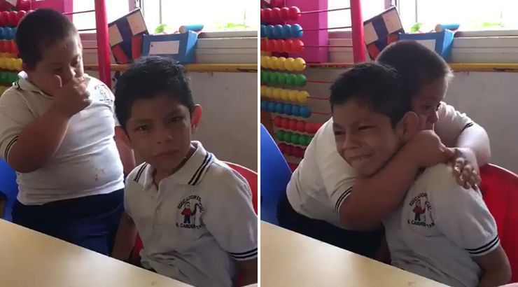 Boy Down Syndrome Comforting Autistic Friend